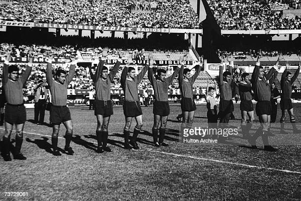 The Independiente football team greet the crowd at the River Plate Stadium in Buenos Aires before beating Boca Juniors in the Copa Libertadores and...