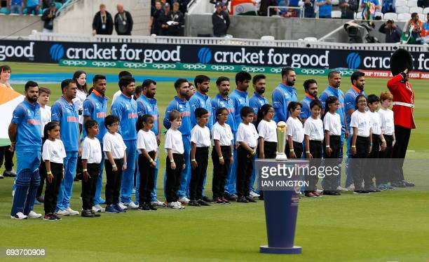 The India cricket team sing their national anthems ahead of the ICC Champions Trophy match between India and Sri Lanka at The Oval in London on June...