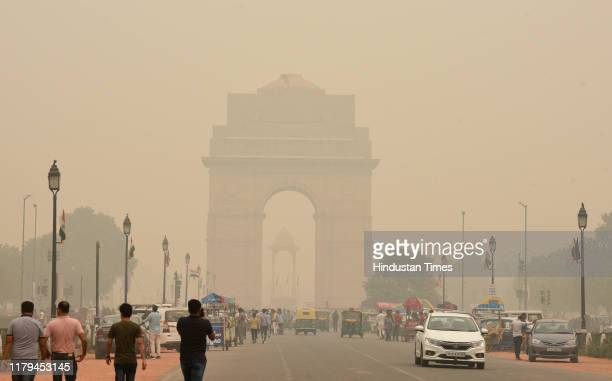 The India Gate monument engulfed in smog at Rajpath, on November 2, 2019 in New Delhi, India. Air quality oscillated between the severe 400 and 500...
