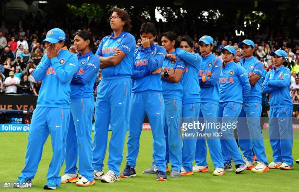 The India side cut dejected figures during the ICC Women's World Cup 2017 Final between England and India at Lord's Cricket Ground on July 23 2017 in...