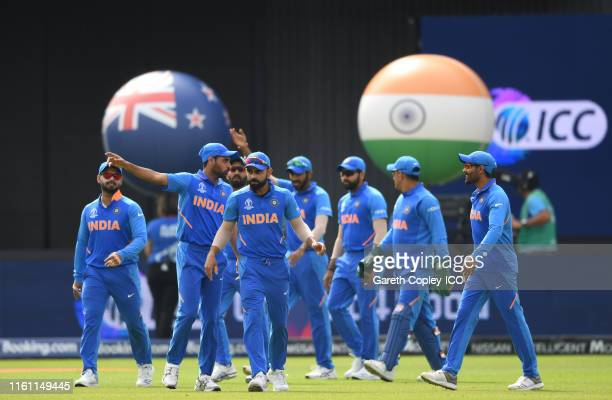 The India side make their way out to field during the Semi-Final match of the ICC Cricket World Cup 2019 between India and New Zealand at Old...