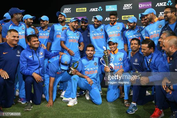 The India squad celebrate the series win during game five in the One Day International series between New Zealand and India at Westpac Stadium on...