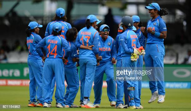 The India team celebrate as Heather Knight is dismissed during the ICC Women's World Cup 2017 Final between England and India at Lord's Cricket...