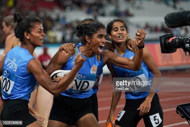 The India team celebrate the final of the women's 4*400m athletics event during on day twelve of the Asian Games on August 30, 2018 in Jakarta,...