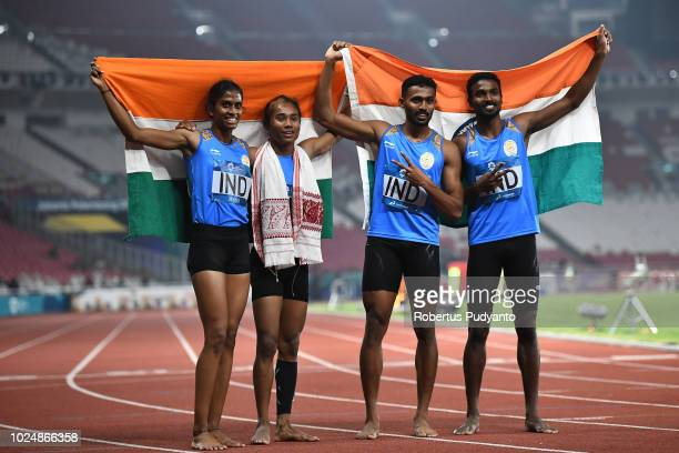 The India team celebrate victory after taking runnerup position during the Mixed 4x400m Relay on day ten of the Asian Games on August 28 2018 in...