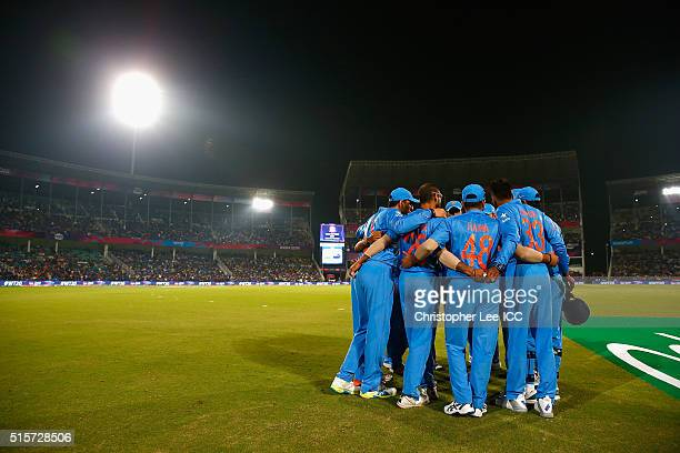 The India team group huddle before they take the field during the ICC World Twenty20 India 2016 Group 2 match between New Zealand and India at the...