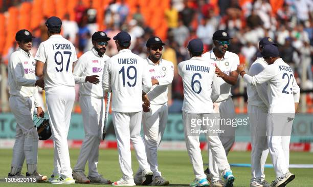 The India team shake hands after victory on Day Three of the 4th Test Match between India and England at the Narendra Modi Stadium on March 06, 2021...