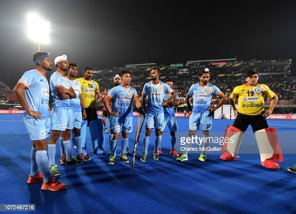 The India team stand dejected on the pitch following the FIH Men's Hockey World Cup quarter final match between India and Netherlands at Kalinga...