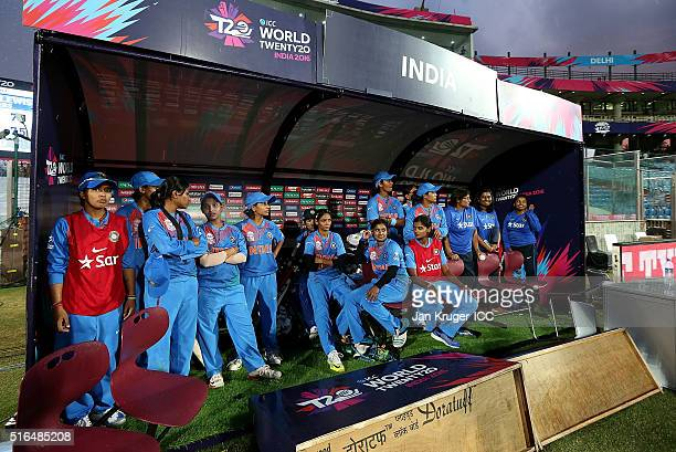 The India team takes shelter from a downpour during the Women's ICC World Twenty20 India 2016 match between India and Pakistan at Feroz Shah Kotla...