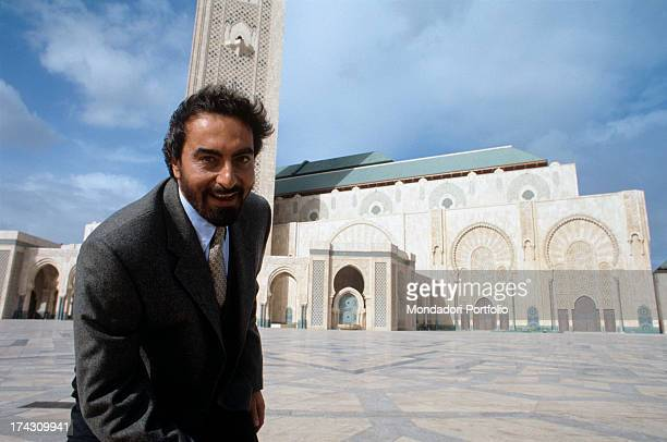 The Indian actor Kabir Bedi is in the coastal area of Casablanca just in front of the magnificent Mosque newly built by king Hassan II he's in...