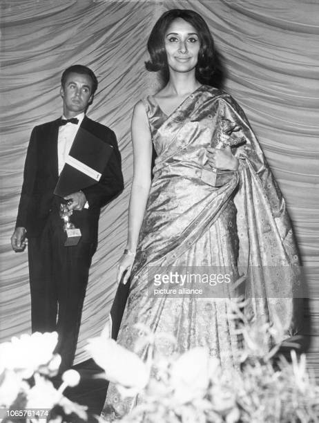 The Indian actress Madhur Jaffrey and the French producer Andre Micheline during the bear award ceremony on 6 July 1965 in Berlin Jaffrey was awarded...