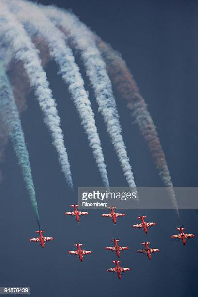 The Indian Air Force's Surya Kiran aerobatics team in MKII aircraft perform during the Air Force Day celebration at Air Force Station in Ghaziabad...