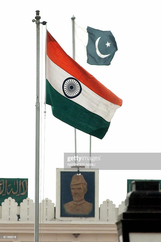 The Indian and Pakistani national flags unfurl at the border gates of India and Pakistan on the IndoPak Joint Border Check Post at Wagah on May 20...