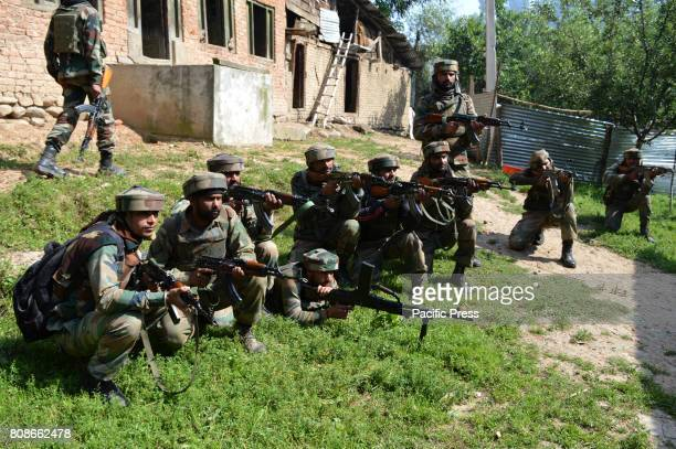 BAMNOO PULWAMA JAMMU KASHMIR INDIA The Indian army soldiers stand alert near the encounter site at Bamnoo village Two local militants Jehangir...