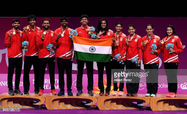 The Indian Badminton Mixed team pose after winning gold in the Mixed Team gold match against Malaysia on day five of the Gold Coast 2018 Commonwealth...