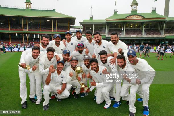 The Indian Cricket Team celebrate winning the Border Gavaskar trophy during day five of the fourth Test match in the series between Australia and...