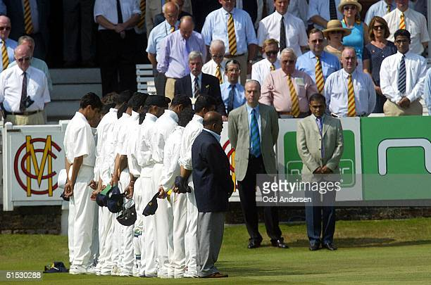 The Indian cricket team observes a minute of silence to pay their respects to the deceased Indian vice President Krishna Kahn before play at Lord's...