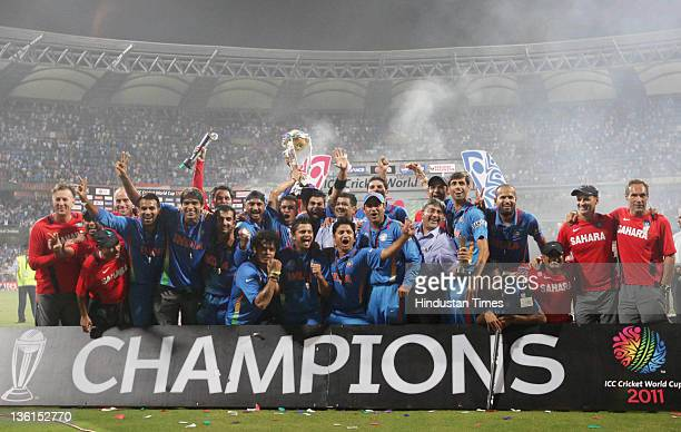 The Indian cricket team pose after they won the final of 2011 ICC World Cup beating Sri Lanka by 6 wickets to become the World Champions at Wankhede...