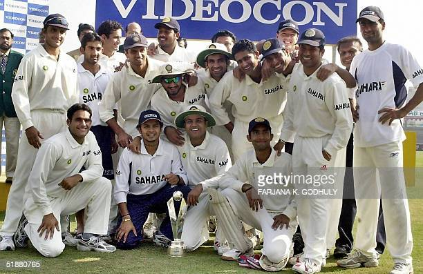 The Indian cricket team poses with the winning trophy after their victory over Bangladesh at the end of the second Test match at the MA Aziz Stadium...