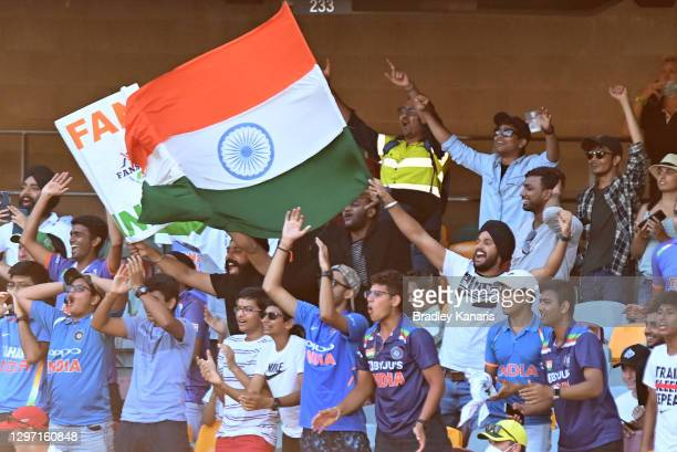 The Indian fans celebrate during day five of the 4th Test Match in the series between Australia and India at The Gabba on January 19, 2021 in...
