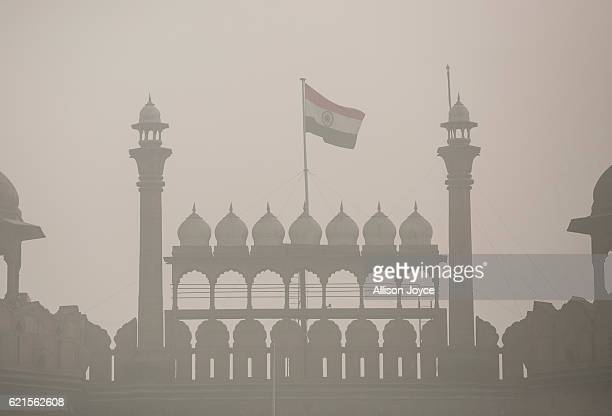 The Indian flag flies on Red Fort amid heavy dust and smog November 7 2016 in Delhi India People in India's capital city are struggling with heavily...
