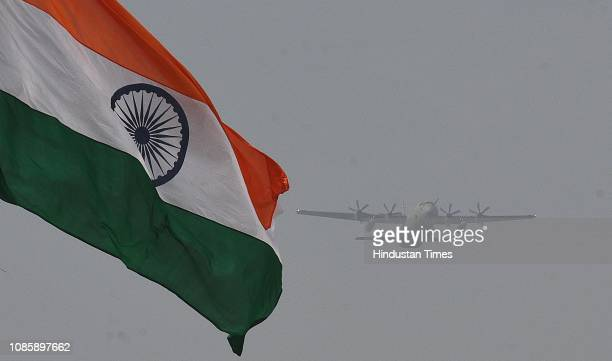 The Indian flag seen as an Indian Air Force fighter plane flies over Rajpath during the rehearsals ahead of the Republic Day parade at Vijay Chowk on...