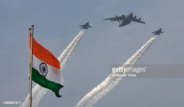 The Indian flag seen as Indian Air Force fighter planes fly over Rajpath during the rehearsals ahead of the Republic Day parade at Vijay Chowk on...