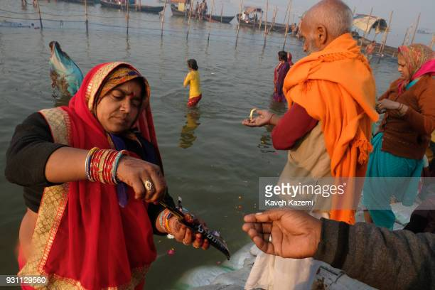 The Indian Hindu devotees offer flowers and candle light by releasing them into Sangam during Magh Mela Festival on January 27 2018 in Allahabad...