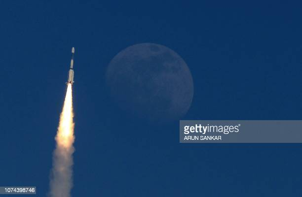TOPSHOT The Indian military communication satellite GSAT7A is pictured next to the moon as it is launched into orbit on the Indian Space Research...