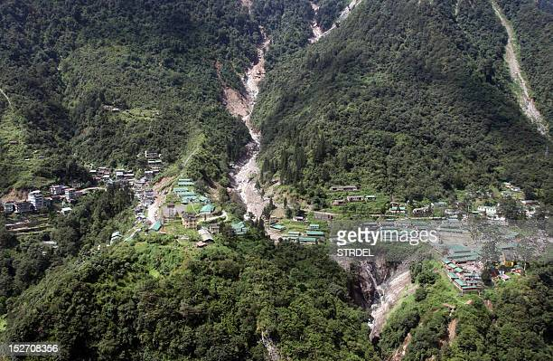 The Indian Mongon – Chungthang road is seen destroyed by a landslide some 30 kms north of the Gangtok the capital of Sikkim on September 24 2012...