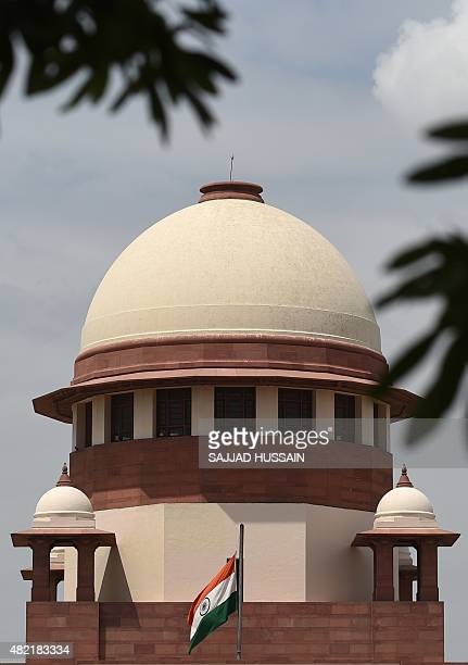 The Indian national flag flies at halfmast on the Supreme Court building following the death of former Indian president APJKalam in New Delhi on July...