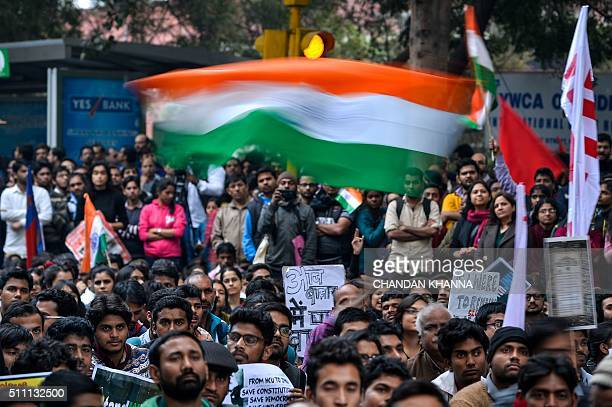 The Indian national flag is waved at a protest against the arrest of an Indian student for sedition in New Delhi on February 18 2016 Thousands of...