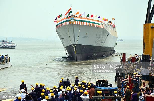 The Indian Navys newly built warship INS Visakhapatnam sails into the Arabian Sea during its launch at Mazagon Dock in Mumbai India Monday April 20...