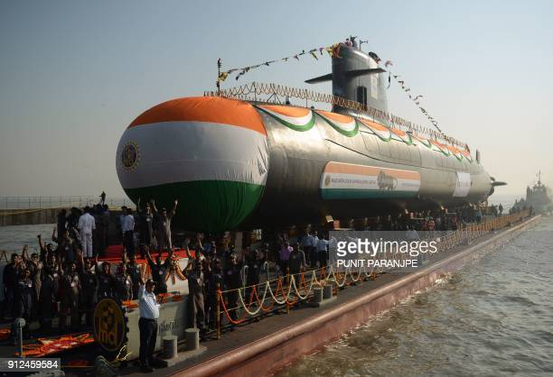 The Indian Navy's third Scorpeneclass submarine 'Karanj' is pulled into the Arabian Sea after its launch ceremony at the Mazagon Dock Shipyard in...