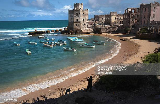 The Indian Ocean meets the warravaged Somali coast as an African Union soldier takes scenic snapshots on August 17 2011 in Mogadishu Somalia After...