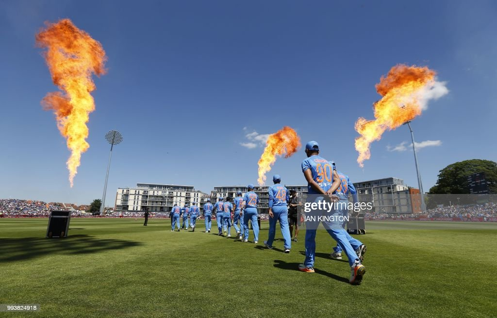 TOPSHOT - The Indian players walk out to field ahead of the third international Twenty20 cricket match between England and India at The Brightside Ground, Bristol on July 8, 2018. (Photo by Ian KINGTON / AFP) / RESTRICTED