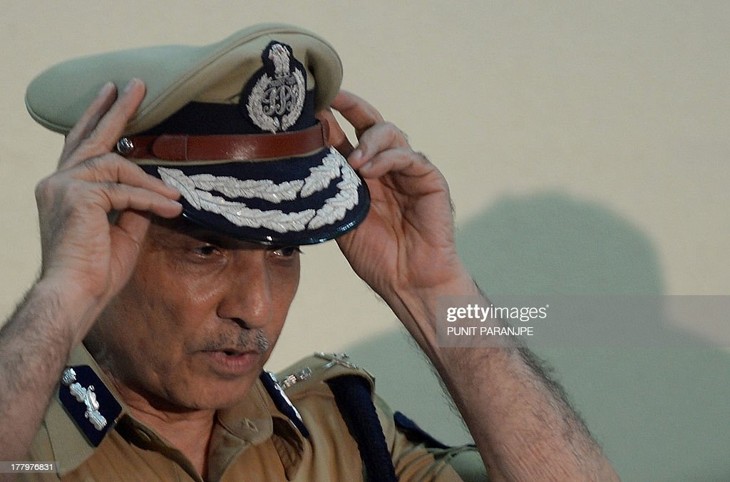 The Indian Police Commissioner of Mumbai, Satyapal Singh, adjusts his cap during a news conference in Mumbai on August on August 26, 2013. Mumbai police on August 25 arrested the fifth and final member of a gang suspected of raping a photographer, a crime that reignited anger about women's safety in India following a similar attack last year.