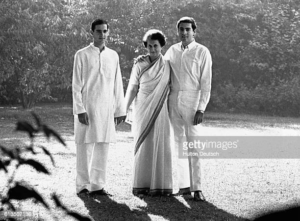 The Indian politician Indira Gandhi stands with her two sons Rajiv and Sanjay in the garden of their Delhi home