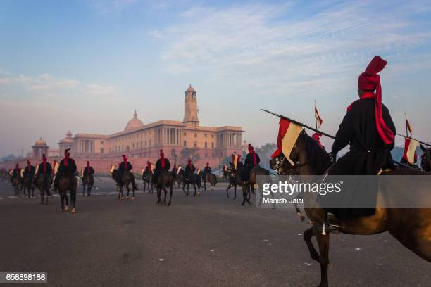 The Indian President's horsemen march at Rajpath on a winter morning as they practice for the Republic day parade.