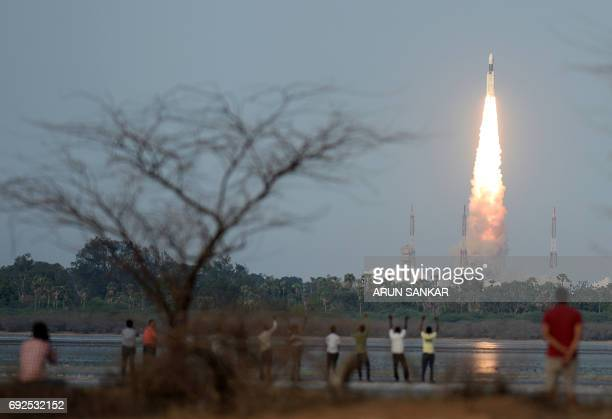 TOPSHOT The Indian Space Research Organisation communication satellite GSAT19 carried onboard the Geosynchronous Satellite Launch Vehicle launches at...