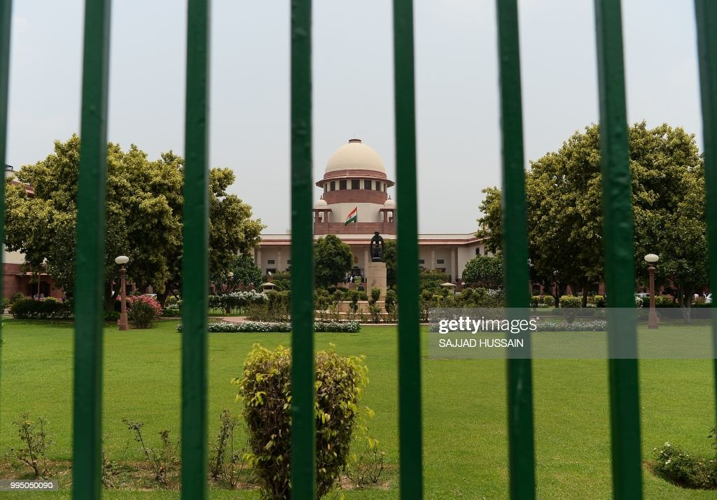 The Indian Supreme Court building is pictured in New Delhi on July 10, 2018. - India's top court began reviewing on July 10, 2018 petitions against a colonial-era ban on homosexuality, in the latest chapter of a legal tussle between social and religious conservatives and more liberal-minded Indians.