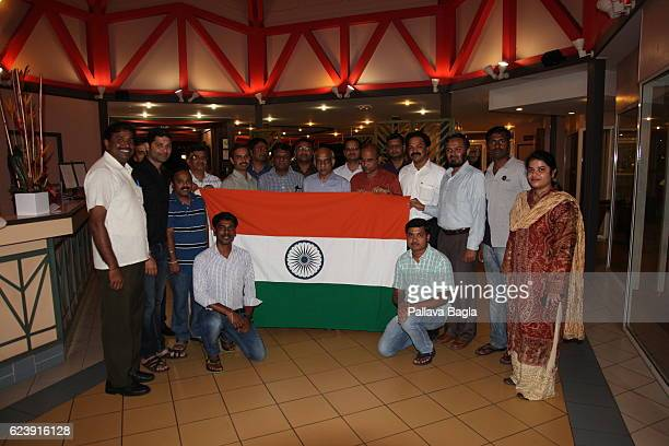 The Indian team at Kourous celebrate a successful launch of the Ariane 5 rocket with India's flag on October 5 2016 in Kourou French Guiana Ariane 5...