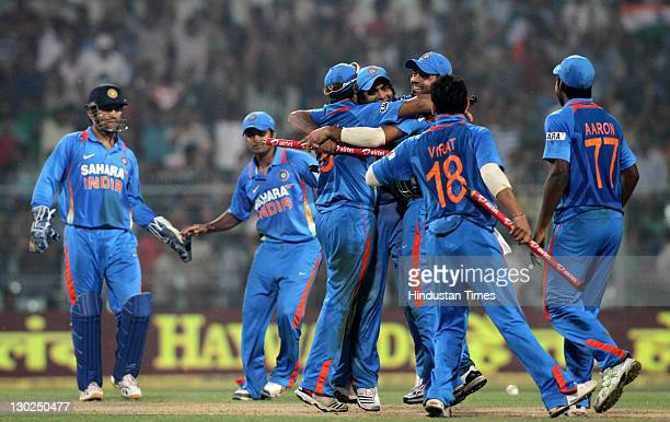 The Indian team celebrate after taking the last wicket of England batsman Steven Finn and winning the match by 95 runs5 runs during 5th One Day...