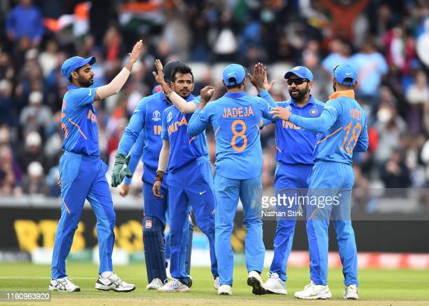 The Indian team celebrate the wicket of Kane Williamson Captain of New Zealand after being dismissed by Yuzvendra Chahal during the SemiFinal match...