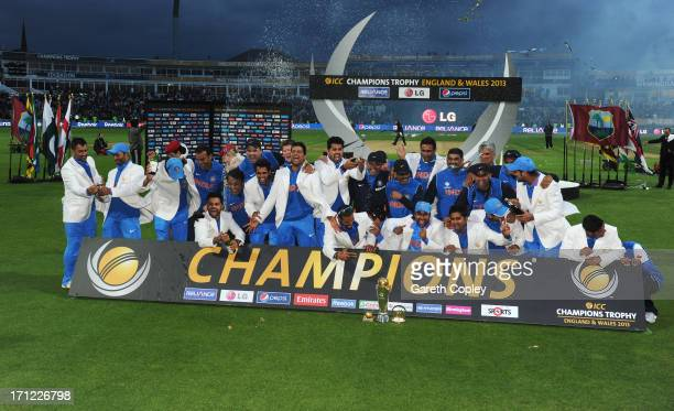 The Indian team celebrate victory during the ICC Champions Trophy Final between England and India at Edgbaston on June 23 2013 in Birmingham England