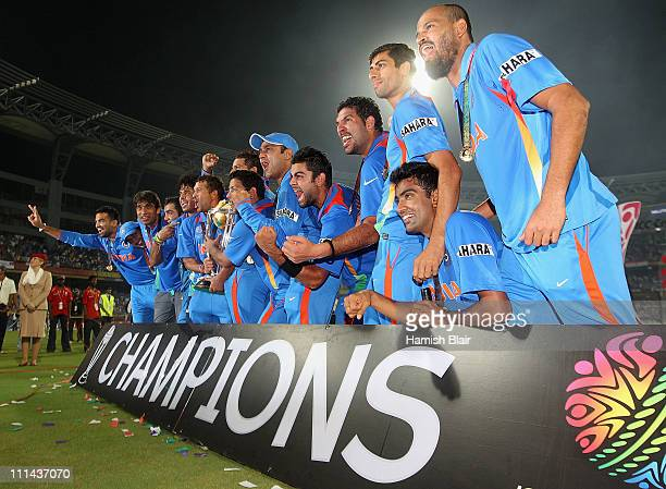 The Indian team celebrate with the trophy after the 2011 ICC World Cup Final between India and Sri Lanka at Wankhede Stadium on April 2 2011 in...