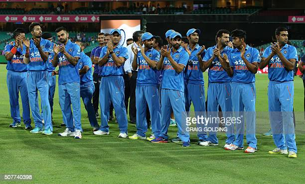 The Indian team celebrates their win after the third Twenty20 international cricket match between India and Australia in Sydney on January 31 2016...