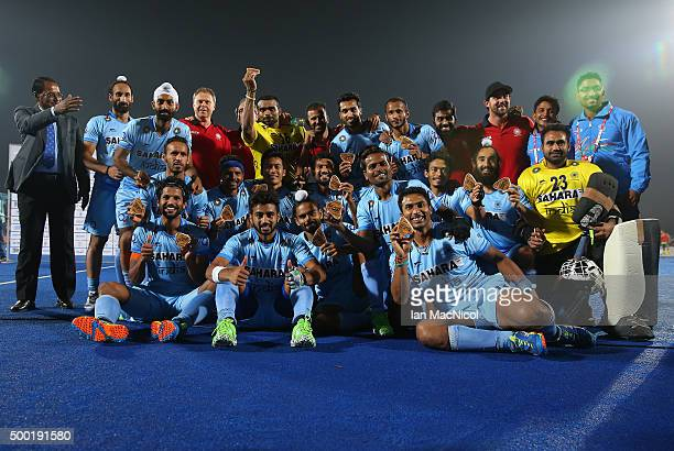 The Indian team pose after winning bronze during the match between Netherlands and India on day ten of The Hero Hockey League World Final at the...