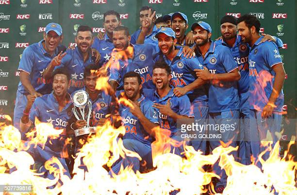 The Indian team pose with the trophy after winning the series 3 0 after the third Twenty20 international cricket match between India and Australia in...
