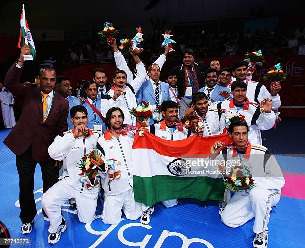The Indian team pose with their gold medals after defeating Pakistan in the Men's Kabaddi Gold Medal match at the 15th Asian Games Doha 2006 at...